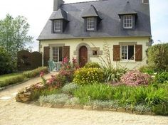 darling French cottage with cottage perrenial garden in front yard....