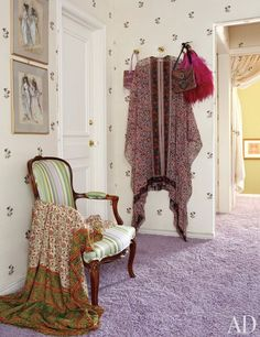 A Kravet embroidered-silk wall covering sheathes her dressing room; the sketches are Irene Sharaff costume designs for the 1968 Burton-Taylor film Doctor Faustus.