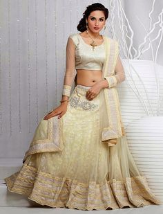 It's time for you to hypnotize and instill awe in everyone as you dress this cream net lehenga choli embellish with lace border, moti work, patch border and resham embroidery work.