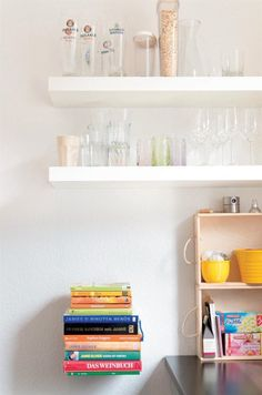 LACK wall shelves and fitted-together wine boxes made of wood.