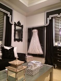 Framed wedding dress in closet...would look great on the big wall across from closet doors! Also, shiny black backing to make the dress and beading pop and match the closet doors.