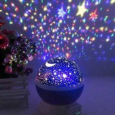 Description: This self-rotating projector lamp lets you meet the sky at close range! Main Features: - Ideal for weddings, birthday parties and all different kinds of settings - Perfect decoration for