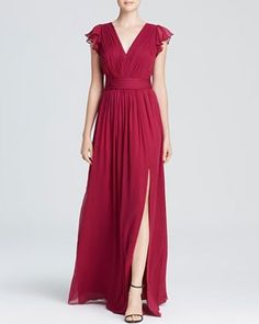 Loving this marsala hued, flutter-sleeved dress featuring an above-the knee-slit. | See more gorgeous floor length bridesmaid dresses here: http://www.mywedding.com/articles/floor-length-bridesmaid-dresses/