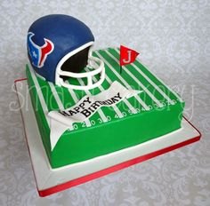 Houston Texans football cake. All edible, helmet is carved from cake.