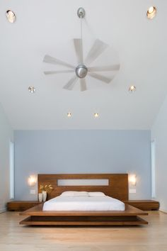 Go minimalist without the starkness by painting a wall or the ceiling in your bedroom a soft icy blue. houzz.com