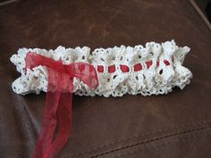 I created this garter for my SIL's upcoming wedding. I wanted to try crocheting a lacey one but coouldn't find just what I was looking for, so I decided to come up with my own. It is pretty quick and easy.