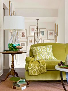 Add character to a space by updating a single piece of furniture. A mossy green sofa adds a splash of personality the white walls and neutral flooring of this living room.