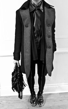 This goth-esque outfit looks a bit too masculine (that's a guy, right?), but I would wear it. Black heels & some earrings will feminize it enough for me. :-)