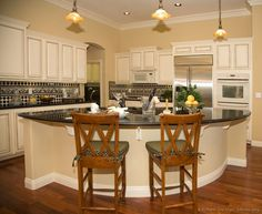 Traditional Antique White Kitchen Cabinets With Curved Island Design Ideas
