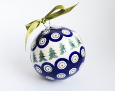 Ball decoration with green christmas trees
