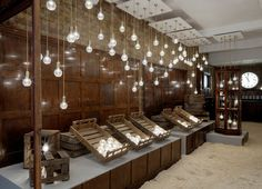 """""""British designer Lee Broom has entirely transformed his East London studio into the Crystal Bulb Shop for the London Design Festival - a general store complete with sawdust floor, mahogany counter and a shopkeeper. London Design Week, London Design Festival, Commercial Design, Commercial Interiors, Retail Interior, Interior And Exterior, Pop Up Shop, Exhibition Display, Exhibition Space"""