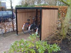 The bicycle cellar is available with or without doors. This bicycle storage … - Innen Garten - Eng Garden Bike Storage, Outdoor Bike Storage, Backyard Storage, Bicycle Storage, Shed Storage, Garage Velo, Carport Garage, Bike Shelter, Corner Garden