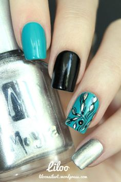 Teal, black, and sparkly silver floral nails. Flower nail art.