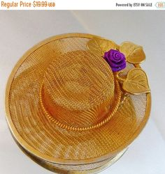 This #vintage gold mesh hat brooch is just beautiful!  It features a gold tone mesh large brim hat with three gold leaves and a purple fabric rosebud.  Rolling C-clasp closu... #ecochic #etsy #jewelry #jewellery