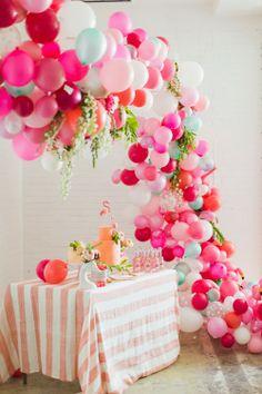 balloon & flower arch in pinks, etc.