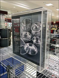 Macys® Cookware department is always a sparkling example of pot and pan presentation (contrast with say, the look of William-Sonoma). Though clear acrylic may not cast much of a shadow, I neverthel… Williams Sonoma, Visual Merchandising, Shadow Box, Clear Acrylic, Cookware, Contrast, Presentation, It Cast, Retail