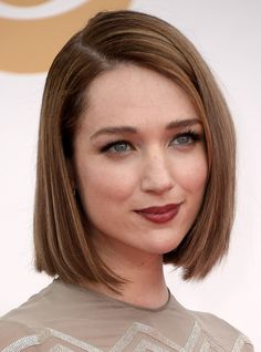2014 Short Hairstyles: Blunt Bob Cut-splendid short hairstyle is featured by smooth and silky. The fabulous sleek bob is razor cut all over to maintain a neat edge. The back is tapered into the neck blending into the layers that frame her side of the face perfectly. The top layers fall greatly to enhance the shape and enhance the smashing look.