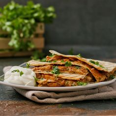 Pulled chicken quesadillas with a spicy BBQ sauce.