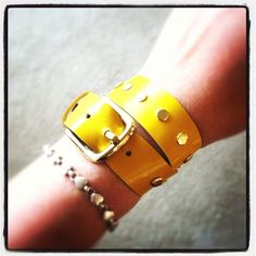 Yellow wrap bracelet with gold hardware. I love this for spring!
