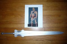 He-Man sword...and possible She-Ra if the other Etsy seller can't make it in time.  http://www.ebay.com/itm/He-Man-or-She-Ra-Custom-Wooden-Power-Sword-Master-of-the-Universe-MOTU-Cosplay-/111545260734?pt=Pretend_Play_Preschool_US&hash=item19f89d9abe