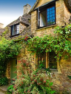 A Cottage in Arlington Row at Bibury, Gloucestershire by Anguskirk
