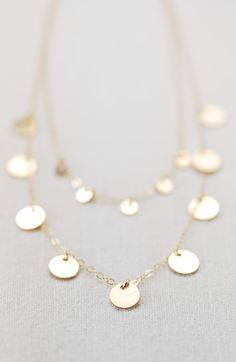Aonani (A oh NA nee) - beautiful daylight.    Shimmery gold double layered necklace. This double strand necklace features rows of gold sequin