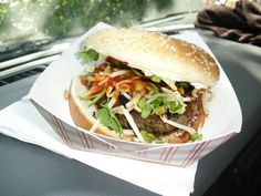 The Nosh Truck's Pad Thai Beef Burger Topped with Bean Sprouts, Green Onions, Cilantro, Peanuts, Sriracha and Mayo