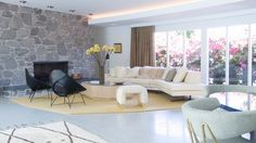 family room furniture ideas decorative stone wall terrazzo floor white sofa black armchairs