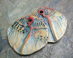 Polymer clay disc drop beads with organic patterns in shades of red-orange and gold