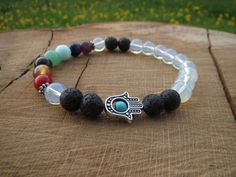 Check out this item in my Etsy shop https://www.etsy.com/listing/235259163/chakra-bracelet-black-lava-stone