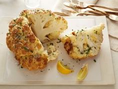 Mustard-Parmesan Whole Roasted Cauliflower : Even meat eaters will want a piece of these impressive, high-fiber veggies. The Dijon mustard concentrates in flavor as it roasts, resulting in a powerful punch of umami. Prep and brush your cauliflower ahead of time, then let them sit at room temperature until you're ready to cook.