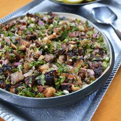 The skin of Philippine pork belly sisig is super crisp (from roasting), and the meat is tangy (from marinating) and juicy (from being braised with aromatics and spices).