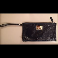 Michael Kors Black Snakeskin Clutch w/wristlet Snake skin black MK clutch. This clutch has inserts inside for credit cards/ID. Also has the option to wear on your wrist. The few times I wore this I was complemented. Michael Kors Bags