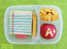 First day lunch. That's a bugle chip with a raisin for the pencil point, and fruit roll-ups making the lines. I think I'd skip the bugle and just attach the raisin; it'll look just as good without weird food. Can cut letters from veggies instead of cheez-its, too.