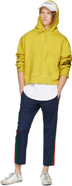 Long sleeve cotton fleece hoodie in 'citronelle' yellow. Exposed seams throughout. Drawstring at hood. Kangaroo pocket at waist. Graphic printed at sleeve. Printed graphic with embroidered trim in black at back. Embroidered logo at cuff. Rib knit cuffs and hem. Silver-tone hardware. Tonal stitching. Available exclusively at SSENSE.