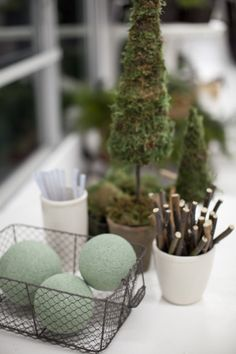 Amazing DIY cone moss and paper trees (and even table runner and paper wreath). I was going to buy the one from Anthro, but now I'll make it! LOVE!