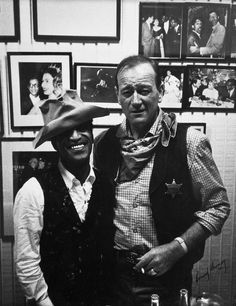Sammy Davis Jr. and John Wayne. For the movie Sergeants 3, John Wayne loaned Sammy Davis Jr. his treasured hat that he had worn in John Ford's Cavalry Trilogy and Rio Bravo amongst other movies. Even with extra padding the hat still fit Sammy loosely. By the time Wayne got the hat back it was badly worn and he threw it away.
