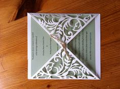 Homemade wedding invitations. Used a die cut to stamp out the paper. Made with love.