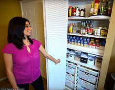 Immaculate: She proudly showed off the pantry in her kitchen, which is meticulously organized