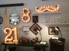 Lighting number or word for the patio wall. At Style-Labo. 5765, bd Saint-Laurent, Montréal