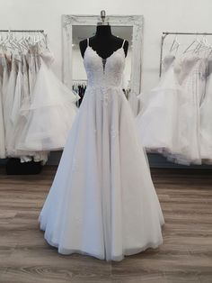 This Chelsea debutante dress has a sweetheart neckline, thin spaghetti straps, a lace-covered bodice with a small see-through panel at the bust. A full glitter tulle skirt with lace applique. Deb Dresses, Formal Dresses, Debutante Dresses, Bella Bridal, Bodice, Neckline, Bridal Wedding Dresses, Lace Applique, Chelsea