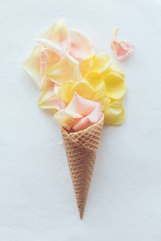 This petal cone looks so pretty, and would be a great decoration for the dessert table! #flowers #roses #petals