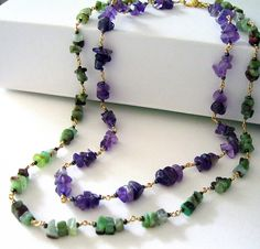 "The stones are a beautiful combination with their vibrant greens and purples. Chinese chrysoprase and amethyst chips beaded with seed beads on anti-tarnish golden brass metal wire, ending with a gold plated lobster clasp. I didn't use any jump rings in this necklace, so each of the beaded links is directly joined to one another forming a strong, and durable chain for long lasting wear. The necklace measures 17"" inches in length and can be altered to any length upon request."