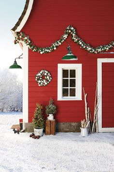 Add a touch of green year-round by installing forest green lamps on the exterior of your home or barn. (Carson L-Arm Fixture, from $199; rejuvenation.com)
