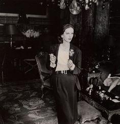 model in chanel suit smoking cigarette1955,Henry Clarke