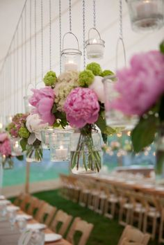 Family Style Dinner   Capers Catering  What a nice idea hanging mason jars filled with peony and hydrangea from the top of the tent.