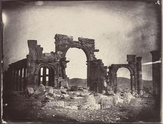 These images from 1864 are the earliest photographs of the Roman ruins at Palmyra. Above: Triumphal arch and great colonnade, Palmyra, Syria. Below: Temple of Bel complex, Palmyra, Syria. Photos by. Palmyra Syria, Classical Antiquity, Ancient Buildings, Triomphe, Historical Images, African History, Ancient Art, Ancient Ruins, Large Art