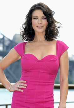 10b7e396ccc7 Catherine Zeta Jones maximizes bust and minimizes shoulder with a  sweetheart neckline. Monochrome palette and diagonal sleeves also create  illusion of ...