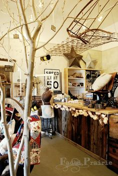 The tree branch, Suspended bed springs or old gate.. great display ideas
