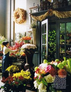 """This photo just gave me a cool idea... I could build a small """"platform out from the outside wall under the small bathroom window and place a wrought Iron-type of fencing on it to make it a """"faux balcony""""!  Cool!!!  Also would be cool over the garage doors & then use as a trellis!"""